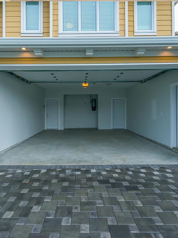 open garage door on yellow two story home